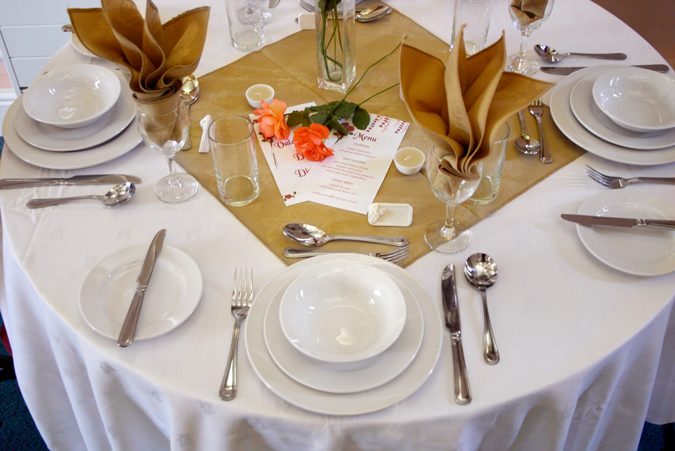 Laid table including spread and crockery 2